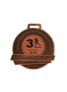 medal odlewany, wykończenie miedź patynowana